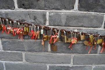 love symbol padlocks chained on the Great Wall