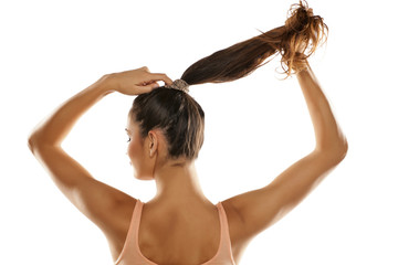 young woman tied her hair in a ponytail