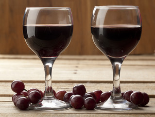 close up shot of red wine and grapes