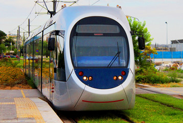 Modern light electric tram on the move, Athens, Greece