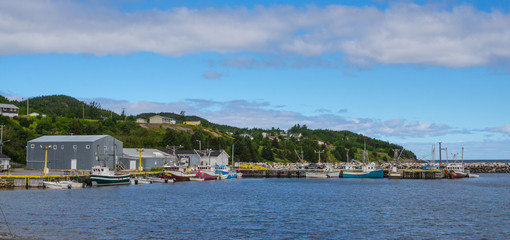 Bonavista, Newfoundland fishing villages.   Boats tied up for the day on calm coastal water.