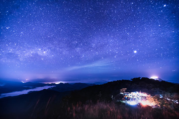 Night landscape with colorful Milky Way.
