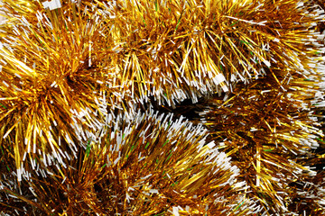 Background of the Christmas tinsel yellow