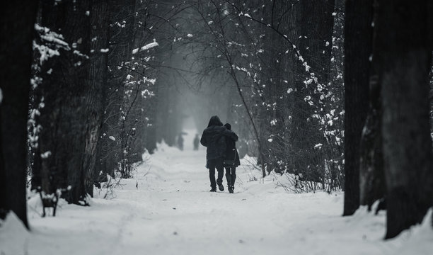 People walk on the winter alley