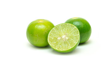 Limes and a half cut with seeds inside on isolated white background.