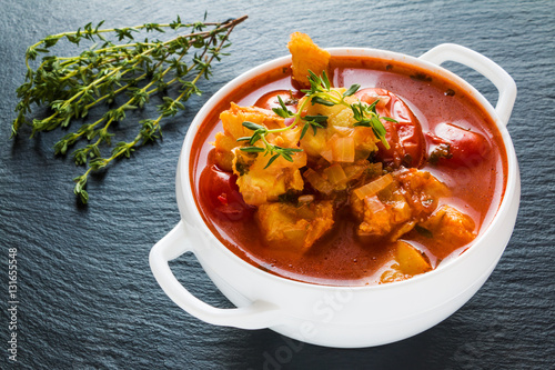 Fish soup with cod tomato onion garlic and thyme in for Fish soup cod