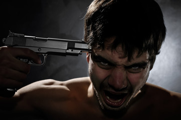 Suicide of a depressed young boy who kills himself by an handgun