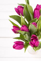 tulip bouquet on white wooden background