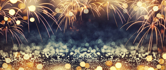 Fototapete - Gold and dark blue Fireworks and bokeh in New Year eve and copy space. Abstract background holiday.