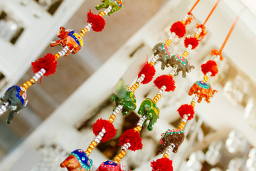 Decorative pendants with colorful elephant figures, beads and po