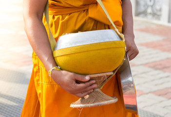 give alms to a buddhist monk
