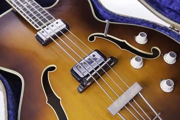 Vintage f-hole semi-acoustic bass guitar