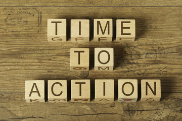 time to action text on wooden cubes on a wooden background