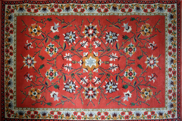 old carpet with national oriental pattern