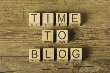 time to blog text on cubes on wooden background