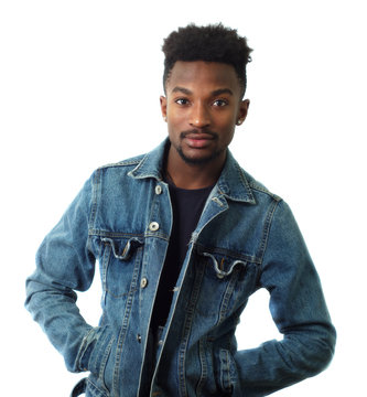 young man on white background studio blue jeans jacket