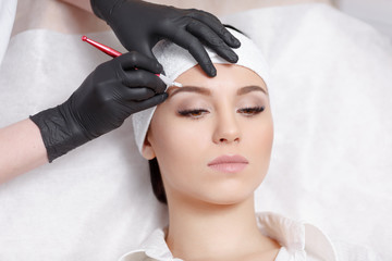Permanent makeup eyebrows.