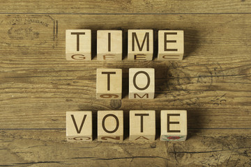 time to vote text on cubes on wooden background