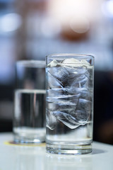 Blue color tone of Drinking water and blurred background.