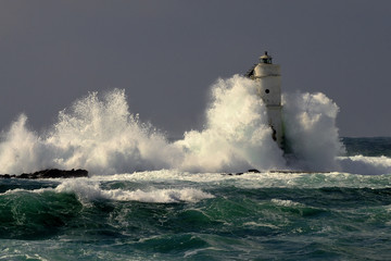 Mangiabarche Sardinia, Italy. Storm. Waves smash against lighthouse or beacon
