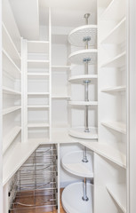 Compact walk in kitchen pantry with lots of shelves, vegetable baskets and lazy susans