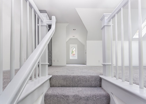 Custom stairs and railings are now carpeted and painted