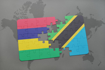 puzzle with the national flag of mauritius and tanzania on a world map