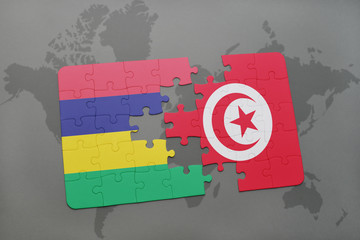 puzzle with the national flag of mauritius and tunisia on a world map