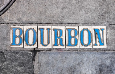 New Orleans sidewalk tiled letters for Bourbon Street in the French Quarter