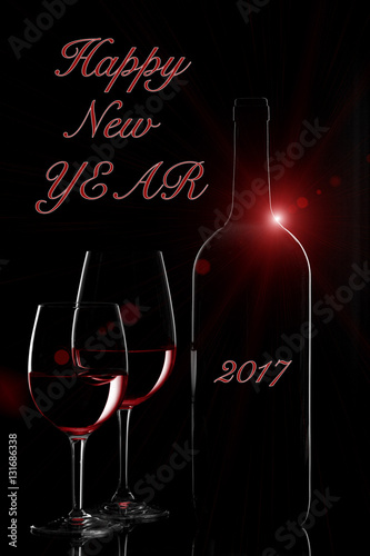 happy new year 2017 greetings with red wine bottle and two wine glasses with flare on