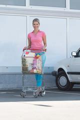 Portrait of Happy Beautiful Woman Near Supermarket