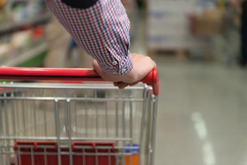 Man Pushing Shopping Cart in Shoe Store Close-up
