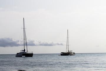 Two Catamaran Sailboats At Anchor Kona Hawaii