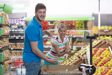 Beautiful Young Couple Shopping In A Grocery Supermarket