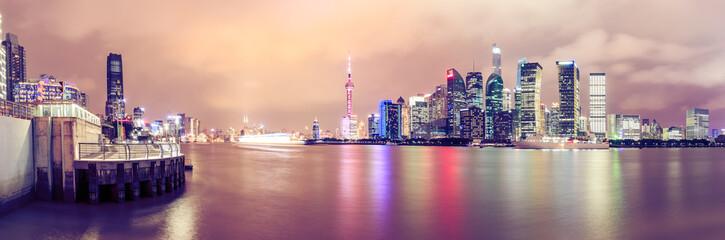 Shanghai skyline and modern cityscape panoramic view at night,China