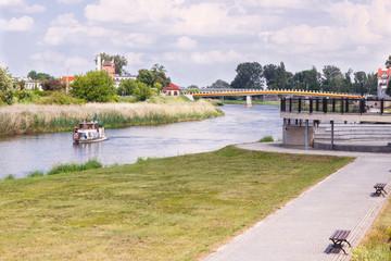 Konin, Poland - June 18, 2016: Embankment of polish Warta river in town Konin