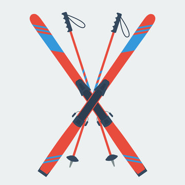 Pair of red skis and ski poles