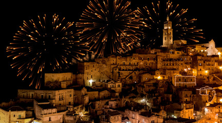 Fotorolgordijn Artistiek mon. panoramic view of typical stones (Sassi di Matera) and church of Matera at night