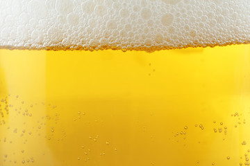 Beer background, foam bubbles. Close-up.