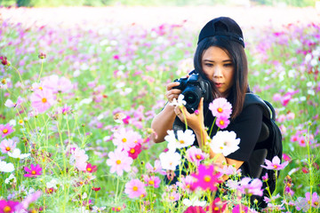 Female Nature Photographer taking pictures outdoors in cosmos fl