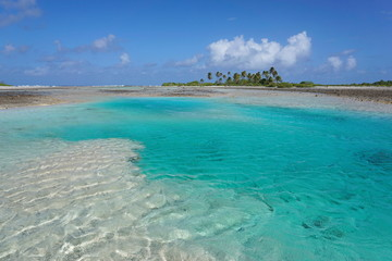 Turquoise water of a shallow channel (hoa) between the ocean and the lagoon, atoll of Tikehau, Tuamotu archipelago, French Polynesia, Pacific ocean