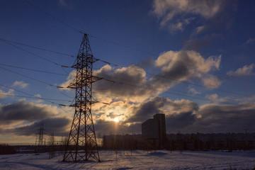 Power line. High voltage post. High-voltage tower over sky backg