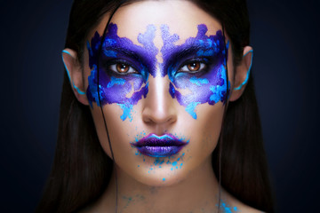Beauty portrait of the girl with Rorschach test on her face. Music Album Cover.