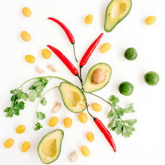 Raw food ingredients of guacamole: avocado, chili pepper, coriander, cherry tomato, lime, garlic. Flat lay, top view. Food concept.
