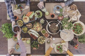 Friends enjoying vegetarian food