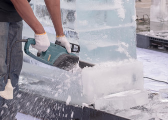 Ice sculpture carving / View of sculptor carving ice. Movement.