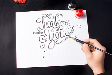 Man writing a Thank you note