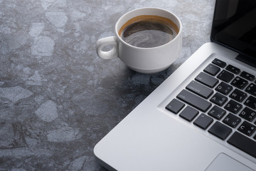Coffee cup with laptop computer