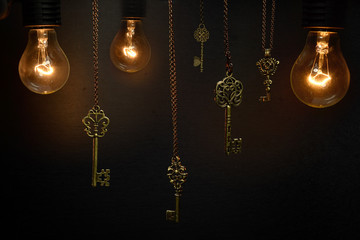 Fototapeta Glühbirnen und Schlüssel obraz