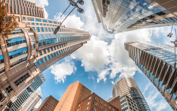 Skyward view of Sydney buildings against blue sky